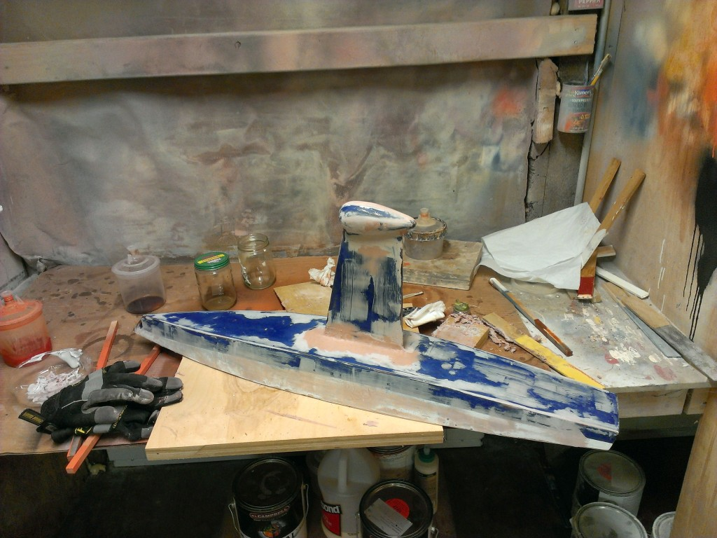 Used some Bondo and a lot of elbow grease to smooth out the contours of the hull.